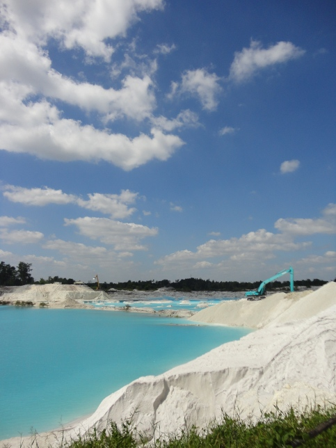 Danau Kaolin. An ex mining lake. Great view for taking photos, blueish water with small sand hills.